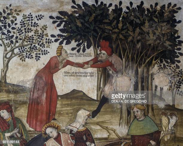 Man trying to drag a woman in the grove detail from the Fountain of Youth fresco in the Baronial Hall Castle of Manta Saluzzo Piedmont Italy 15th...