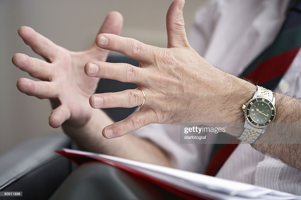 A man trying to express something using his two hands : Bildbanksbilder