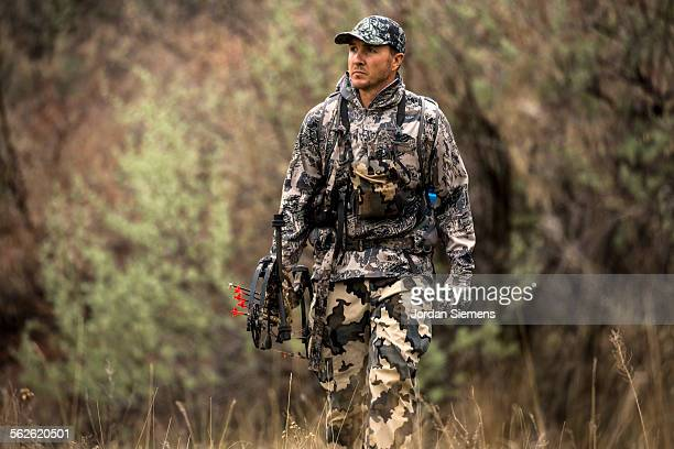 a man turkey hunting. - turkey hunting stock photos and pictures