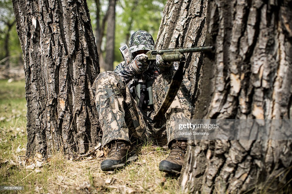 A man dressed in camouflage out turkey hunting in Montana.