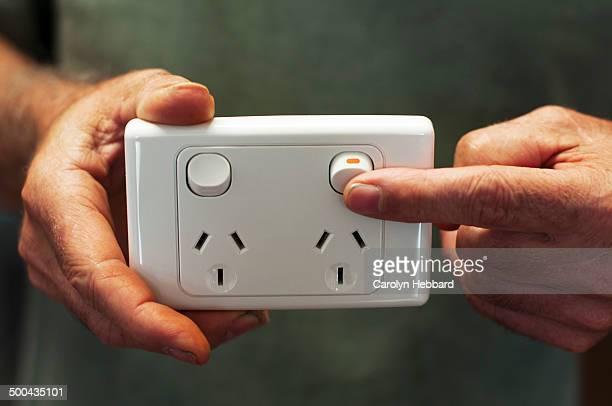 Man turning on power switch