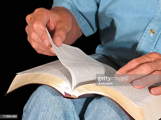 Man Turning Page of Bible (KJV)