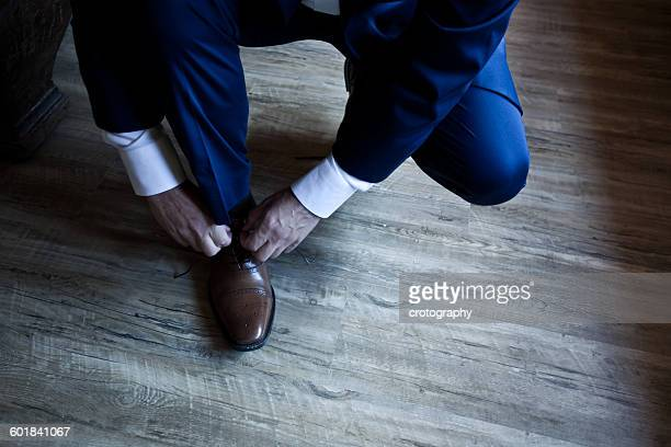 Man tying his shoelaces