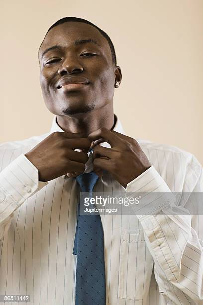 Man tying neck tie