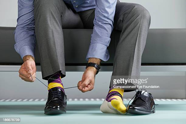 Man tying shoe laces