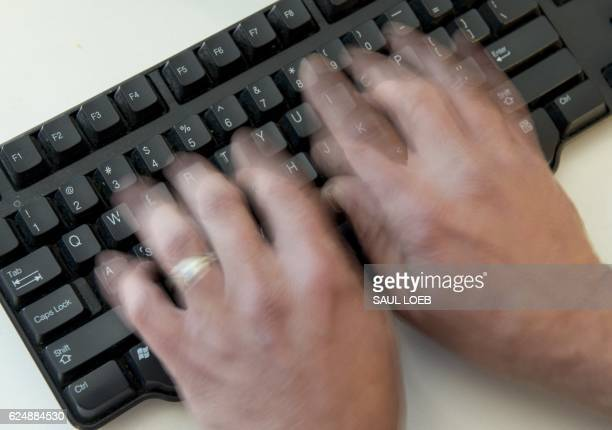 A man types on a computer keyboard in this photo illustration taken in Washington DC November 21 2016 Almost half of US internet users say they have...