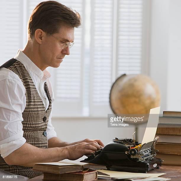 Man typing on antique typewriter