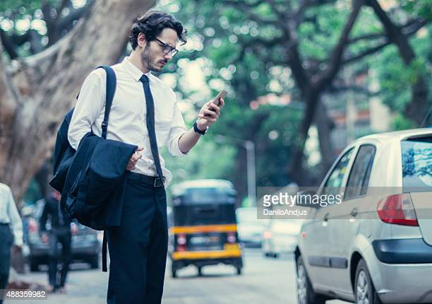 man typing text message after work