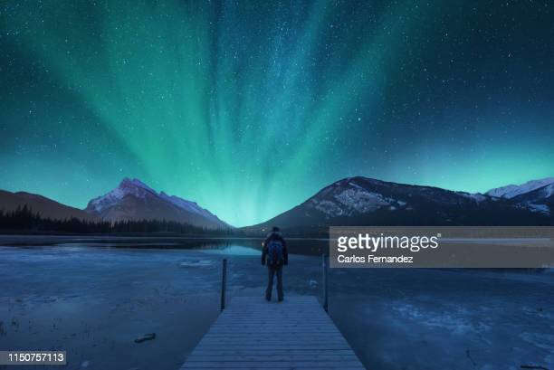 man under aurora - banff national park stock pictures, royalty-free photos & images
