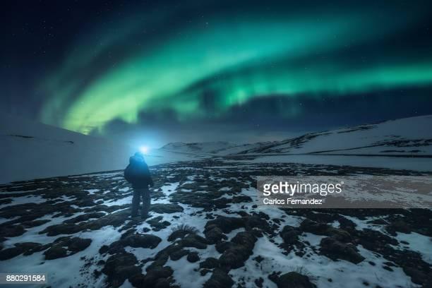 Man under northern lights