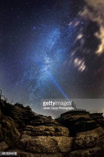 man under the milky way - north star stock pictures, royalty-free photos & images