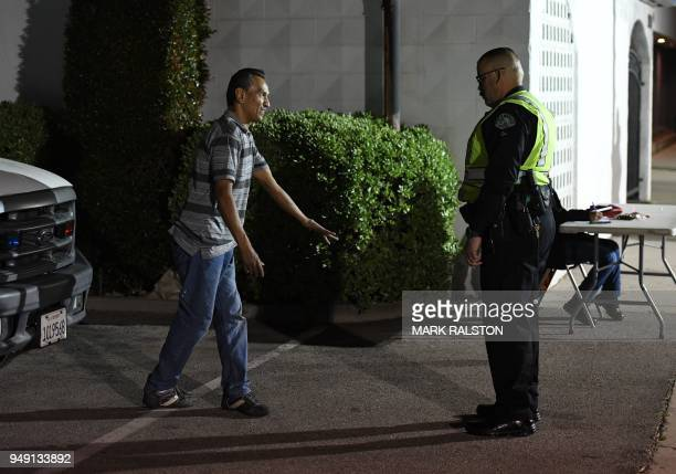 A man undergoes a sobriety test at a LAPD police DUI checkpoint in Reseda Los Angeles California on April 13 2018 Pot may be legal in eight US states...