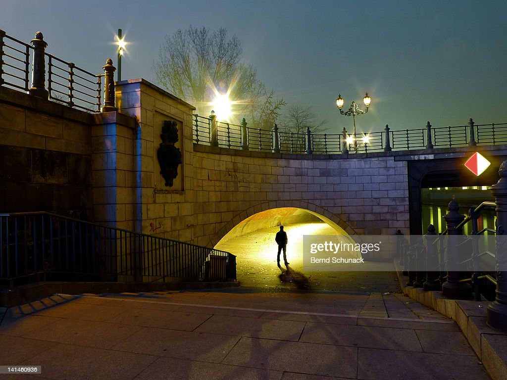 Man underpass from bridge : Stock Photo