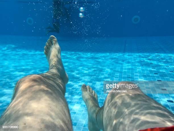 Man underwater in pool - POV