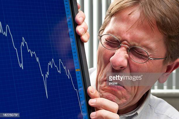 man unhappy about sinking stock exchange rate - distressed stock market people stock pictures, royalty-free photos & images