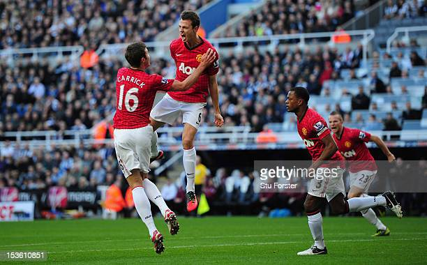 Man United player Jonny Evans celebrates after scoring the first goal during the Barclays Premier league game between Newcastle United and Manchester...
