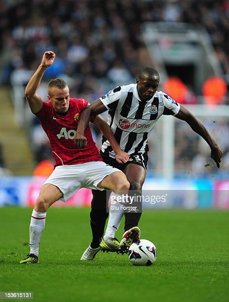 Man United player Tom Cleverley is challenged by Shola Ameobi during the Barclays Premier league game between Newcastle United and Manchester United...