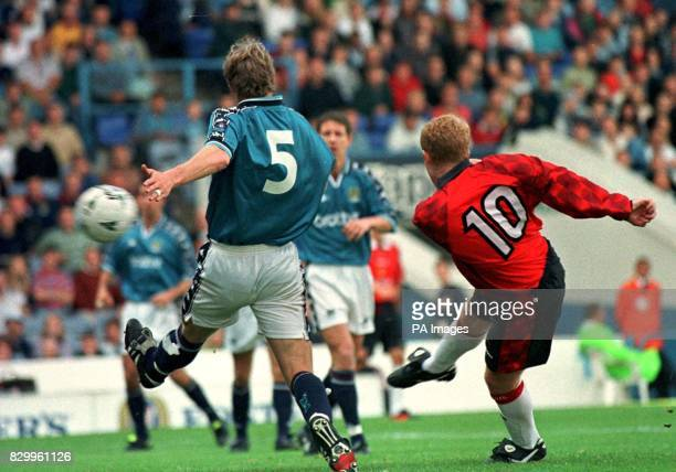 Man United's Paul Scholes puts the ball past Man City's Ian Brightwell for the first goal in todays Paul Lake testimonial game Photo by Paul Barker/PA