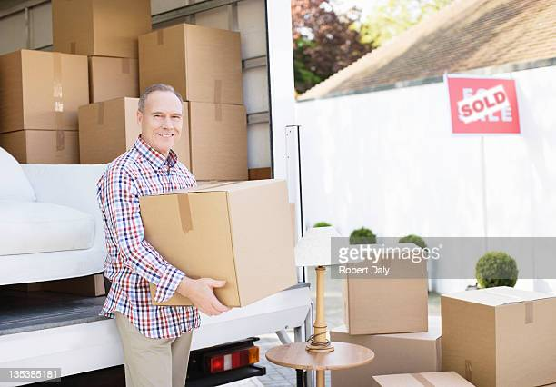 Man unloading box from moving van