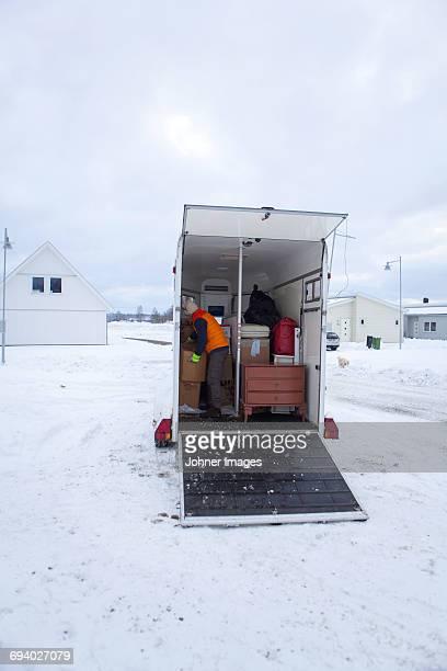 Man unloading boxes