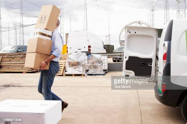 man unloading van with boxes - transportation stock pictures, royalty-free photos & images