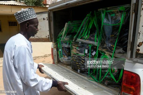 A man unlocks the booth of a truck carrying election card readers loaded in ballot boxes which arrived at the headquarters of the Independent...