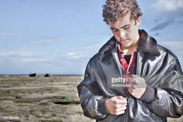 Man unzipping his jacket
