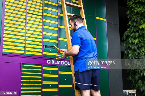man up ladder changing order of play outside tennis court, wimbledon, uk - grass court stock pictures, royalty-free photos & images