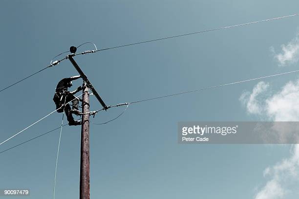 Man up telephone pole