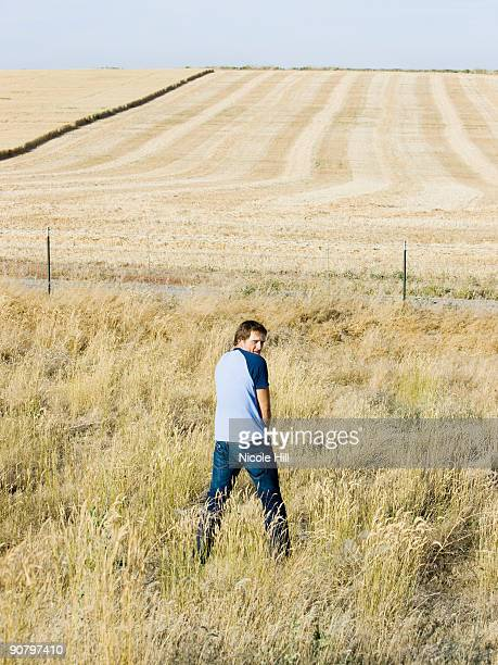 man urinating along the side of road