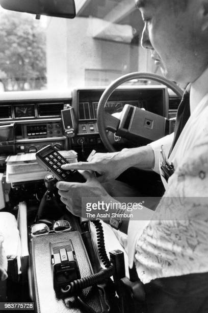 A man use a car phone on June 4 1987 in Tokyo Japan