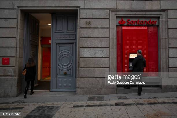 Man uses a cash machine at a Banco Santander's office a day before a news conference to announce the 2018 results on January 29, 2019 in Madrid,...