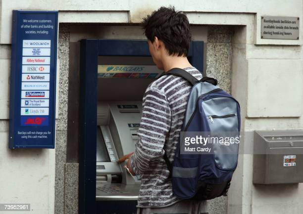 A man uses a cashpoint at a branch of Barclays Bank near Tower Bridge on April 23 2007 in London It is reported that Dutch bank ABN Amro have...
