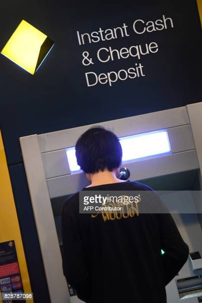 A man uses a Commonwealth Bank ATM in Sydney on August 3 2017 Australia's biggest bank was on August 3 taken to court by the country's financial...