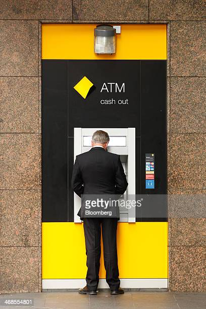 A man uses a Commonwealth Bank of Australia automated teller machine at one of the bank's branches in Sydney Australia on Monday Feb 10 2014...