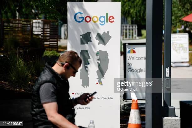 Man uses a mobile device on the Google campus as Google workers inside hold a sit-in to protest sexual harassment at the company, on May 1, 2019 in...