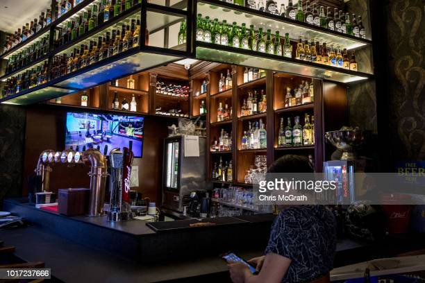 A man uses a mobile phone at a bar on August 15 2018 in Istanbul Turkey The Turkish Lira recovered to trade at 61 USD despite President Erdogan...