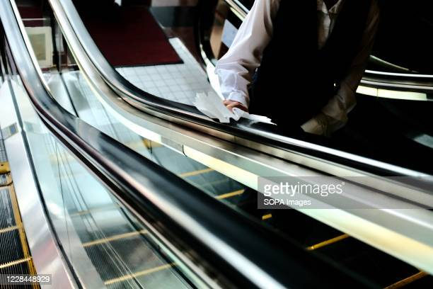 Man uses a paper towel to avoid touching public escalator with bare hands in Hong Kong. A spokesman for the Food and Health Bureau said starting 11...