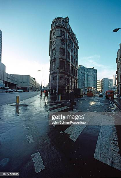 A man uses a pedestrian crossing in a street in central Manchester England in 1976
