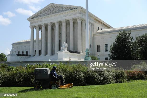 Man uses a riding lawn mower to cut the grass in front of the U.S. Supreme Court July 08, 2020 in Washington, DC. In a dual victory for religious...