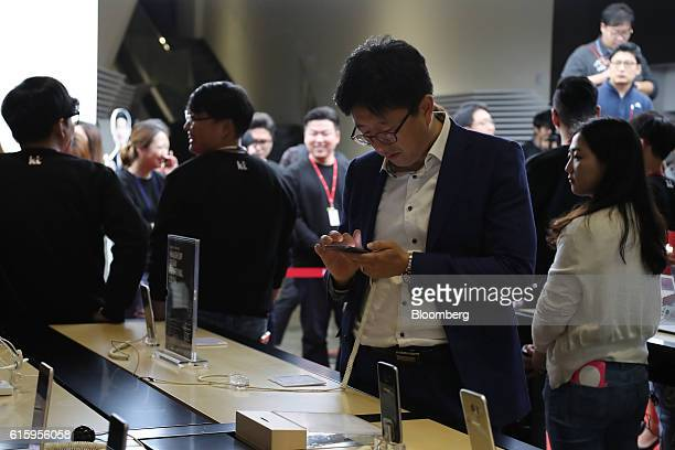 A man uses a Samsung Electronics Co Galaxy S7 Edge smartphone during the release of the Apple Inc iPhone 7 at KT Corp's Olleh Square flagship store...