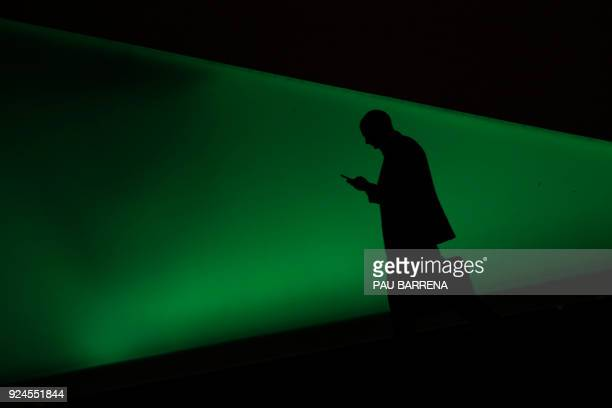 A man uses a smartphone on the first day of the Mobile World Congress on February 26 2018 in Barcelona The Mobile World Congress the world's biggest...