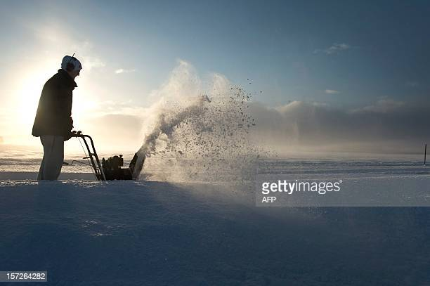 A man uses a snow blower to clear a small road leading to his farm in Saleby outside Skara in southwestern Sweden on December 1 2012 The Swedish...