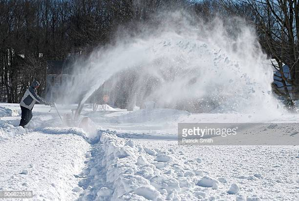 A man uses a snowblower on January 24 2016 in Forest Hill Maryland Heavy blanketed the MidAtlantic region with upwards of 30 inches of snow and...