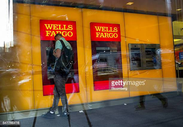 A man uses a Wells Fargo Co automated teller machine inside a bank branch in New York US on Tuesday July 12 2016 Wells Fargo Co is scheduled to...