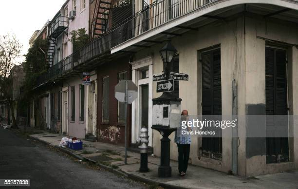A man uses a working payphone in the French Quarter September 6 2005 in New Orleans Louisiana Once one of America's hottest nightspots the famous...