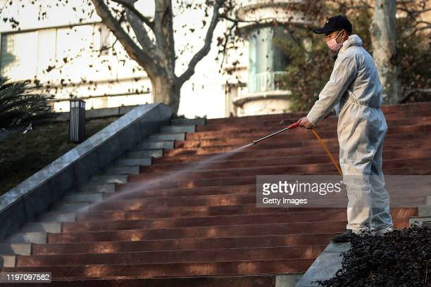 A man uses alcohol to disinfect the grounds nearby the Wuhan Huoshenshan hospital construction site on January 28 2020 in Wuhan China Wuhan...