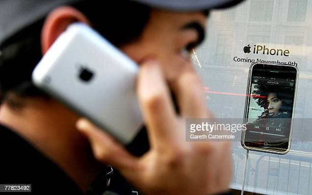 A man uses an Apple iPhone outside the Apple store on Regent Street on device's UK launch day November 9 2007 in London England The November 9 UK...