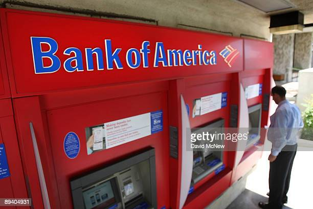 A man uses an ATM at a Bank of America branch on July 28 2009 in Pasadena California A bank spokesperson announced plans to close about 10 percent of...