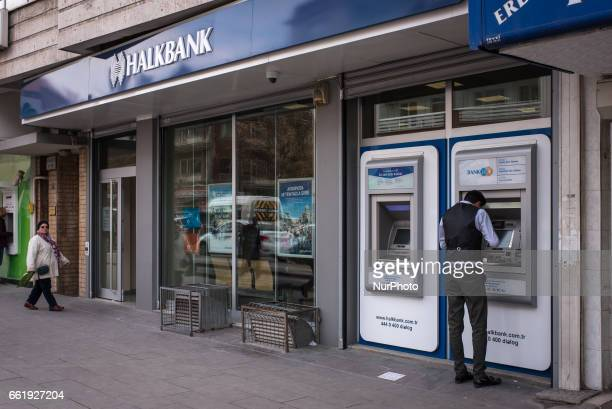 Man uses an ATM to withdraw money at a branch office of Halkbank BranchTurkish staterun bank Halkbank had its deputy general manager Mehmet Hakan...